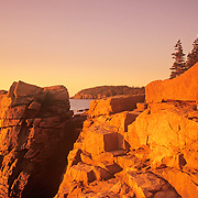 Rocky coast at sunrise. Thunder Hole along the Ocean Drive. Acadia National Park. Mount Desert Island, Maine