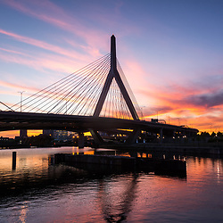 Boston Zakim Bunker Hill Bridge at sunset photo. The Leonard P. Zakim Bunker Hill Memorial Bridge is a cable bridge that spans the Charles River in Boston, Massachusetts in the Eastern United States of America.