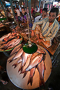 A vendor sells fish at the sprawling Sonargaon market in Sonargaon, outside Dhaka, Bangladesh.
