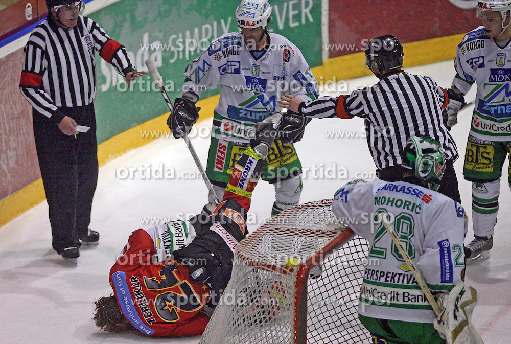 Ralph Intranuovo of Olimpija had a fight with Anze Terlikar of Jesenice in second round of ice hockey match Acroni Jesencie vs ZM Olimpija in second round of final of Slovenian National Championship,  on April 5, 2008 in Arena Podmezaklja, Jesenice, Slovenia. Acroni Jesenice won the game 6:1 and lead the series 2:0.  (Photo by Vid Ponikvar / Sportal Images)