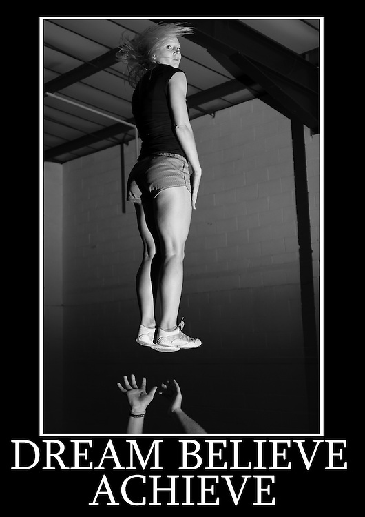 Motivational cheerleading poster of a single based partner stunt full around with a phrase that reads Dream Believe Achieve.<br />