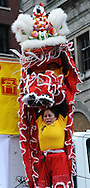 February 13, 2011 - Gund Kwok member Jennifer Chiu lifts partner Lillian Chan in the air as part of their Lion Dance performance during New Year celebrations in Boston's China Town.