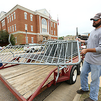 Adam Robison | BUY AT PHOTOS.DJOURNAL.COM<br /> Donald Dykes and Jake Logan, Tupelo Public Works employees, unload barricade gates in front of City Hall at Fairpark Thursday morning in Tupelo for this weekends Color Vibe 5K and NOleput festival