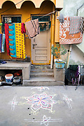 KADIRI, INDIA - 01st November 2019 - Decorative floral pookalam / rangoli motif outside home in residential area of Kadiri town centre, Andhra Pradesh, South India