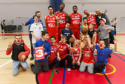 Roy Owen, Alif Bland, Jordan Ranklin and Greg Streete of Bristol Flyers pose with young fans all wearing is shown a red card by Noses in support of Comic Relief - Photo mandatory by-line: Rogan Thomson/JMP - 07966 386802 - 07/03/2015 - SPORT - BASKETBALL - Bristol, England - SGS Wise Arena - Bristol Flyers v Sheffield Sharks - BBL Championship.