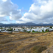 A view on the city of Yaiza, Lanzarote, with the Timanfaya national park in the background.