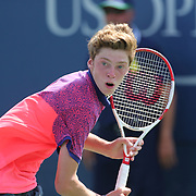 Andrey Rublev, Russia, in action during his  match against Francis Tiafoe, USA, in the Junior Boys' Singles Quarterfinals during the US Open Tennis Tournament, Flushing, New York, USA. 5th September 2014. Photo Tim Clayton