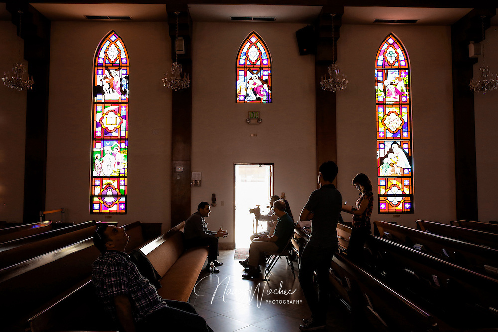 Chaldean Catholics talk to journalists about the plight of Christians in Iraq inside St. Peter Chaldean Catholic Cathedral in El Cajon, Calif., Aug. 14, 2015. Activist Mark Arabo (second from left) has urged the Obama administration and members of Congress to come to the aid of Iraqi Christians. (Nancy Wiechec for ONE magazine)