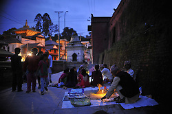 September 6, 2016 - Kathmandu, Nepal - Nepalese devotees offering ritual prayer at the Bank of Bagmati River of Pashupatinath Temple during Rishi Panchami Festival celebrations at Pashupatinath Temple, Katmandu, Nepal on Tuesday September 06, 2016. Rishi Panchami festival is celebrated as the last day of three-day long Teej Festival. The Teej festival is celebrated by Hindu women in Nepal as well as in some parts of India.  During the three-day long festival, women observe a day-long fast and pray for the long life their husbands as well as for a happy family. Those who are unmarried pray for a good husband and a long life. (Credit Image: © Narayan Maharjan/Pacific Press via ZUMA Wire)