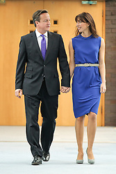 © Licensed to London News Pictures. 10/10/2012. Birmingham , UK . The British Prime Minister , David Cameron , arrives with his wife , Samantha , before delivering his closing speech to the 2012 Conservative Party Conference . Day 4 of the Conservative Party Conference at the International Convention Centre in Birmingham . Photo credit : Joel Goodman/LNP