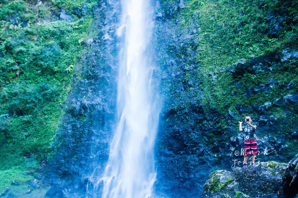 Boy taking a selfy at the Hanakoa Falls, Na Pali Coast, Kauai, Hawaii