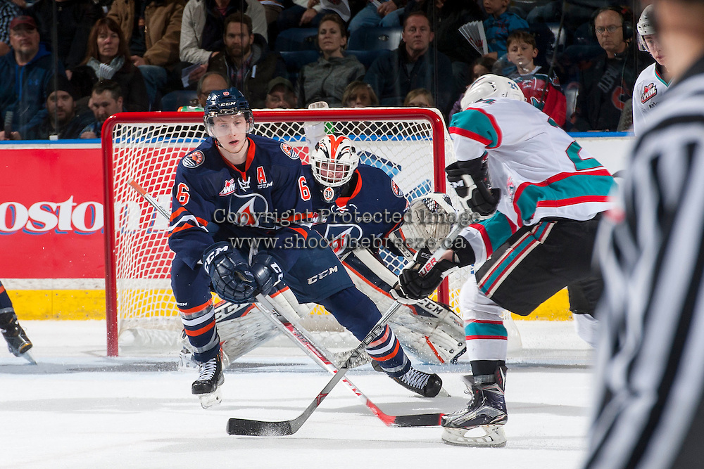 KELOWNA, CANADA - MARCH 25: Dallas Valentine #6 blocks a shot on Connor Ingram #39 of Kamloops Blazers against the Kelowna Rockets on March 25, 2016 at Prospera Place in Kelowna, British Columbia, Canada.  (Photo by Marissa Baecker/Shoot the Breeze)  *** Local Caption *** Dallas Valentine; Connor Ingram;