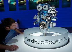 Man examines new efficient Eco Boost engine frrom Ford at the Frankfurt Motor Show 2009