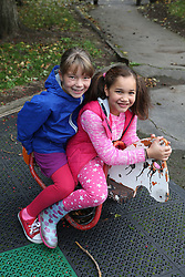 Two girls on rocking horse