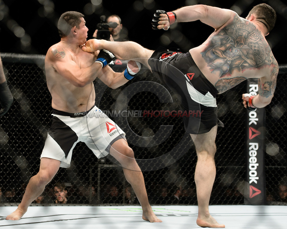 GLASGOW, SCOTLAND, JULY 18, 2015: Daniel Omielańczuk (black shorts with white stripe) defeats Chris De La Rocha via TKO during UFC Fight Night 72 inside the SSE Hydro Arena in Glasgow. (Martin McNeil for ESPN)