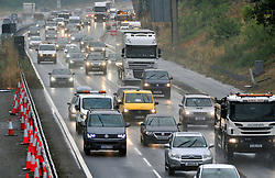 &copy; Licensed to London News Pictures. 09/08/2018. Maidstone, UK. Wet weather journey for drivers on the M20 in Kent near Maidstone, as the sunny weather is replaced with rain.<br /> Photo credit: Grant Falvey/LNP