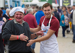 NO REPRO FEE: (L-R) A well fed Pat Prendergast from Claremorris is pictured with Celebrity MasterChef winner David Gillick who was cooking up a storm at the Electric Ireland stand at the 2013 National Ploughing Championships yesterday. With three showcase demonstrations each day, David is creating some of his favourite healthy dishes for visitors to the Electric Ireland stand. Picture Andres Poveda