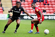 Barnsley defender Dimitri Cavare (12) and Walsall FC forward Corey Blackett-Taylor (38) during the EFL Sky Bet League 1 match between Walsall and Barnsley at the Banks's Stadium, Walsall, England on 23 March 2019.