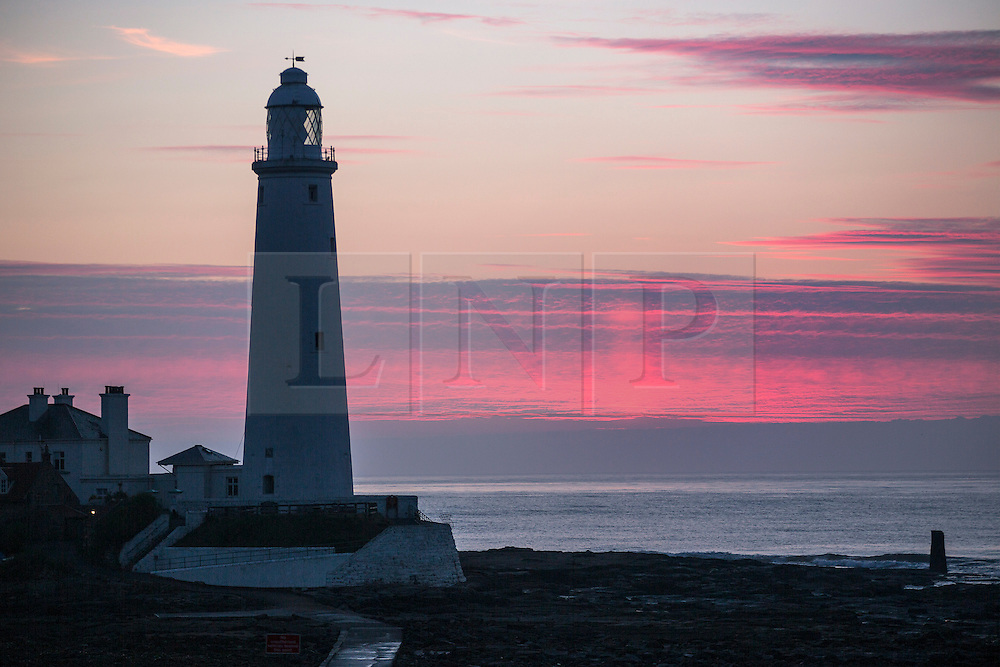 © Licensed to London News Pictures. 24/06/2015. Whitley Bay.UK. Picture shows the Whitley bay lighthouse in the early morning light. Forecasters are predicting a dry but cloudy day with sunny spells this morning. Photo credit : Andrew McCaren/LNP