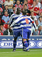 DAN SHITTU celebrates with MARC BIRCHAM after putting QPR 1-0 up<br /> SOUTHAMPTON v. QPR<br /> Championship<br /> St. Marys<br /> 10-9-05<br /> Photo:SEAN RYAN<br /> 07971 400939
