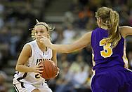 December 22 2010: Iowa guard Jaime Printy (24) looks to pass by Northern Iowa guard Rachel Madrigal (3) during the first half of an NCAA college basketball game at Carver-Hawkeye Arena in Iowa City, Iowa on December 22, 2010. Iowa defeated Northern Iowa 75-64.