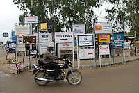 Sign indicating foreign companies in Gurgaon, New Delhi's CDB.