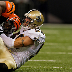 2009 August 14: New Orleans Saints linebacker Scott Shanle (58) tackles Cincinnati Bengals running back Bernard Scott (28) during a preseason opener between the Cincinnati Bengals and the New Orleans Saints at the Louisiana Superdome in New Orleans, Louisiana.