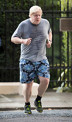 © Licensed to London News Pictures. 18/07/2017. London, UK. Foreign Secretary Boris Johnson returns from a jog - wearing a t-shirt bearing French slogans - before attending cabinet. Photo credit: Peter Macdiarmid/LNP