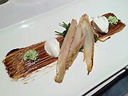 Vienna, Austria. Restaurant Five Senses.<br /> Starter.<br /> Gegrillter Trevisio | Soja-Balsamico-Waldhoniglack | cremiger Ziegenkäse | Rucolacreme<br /> Grilled trevisio | soya-balsamico-wild honey | creamy goat cheese | arugula cream