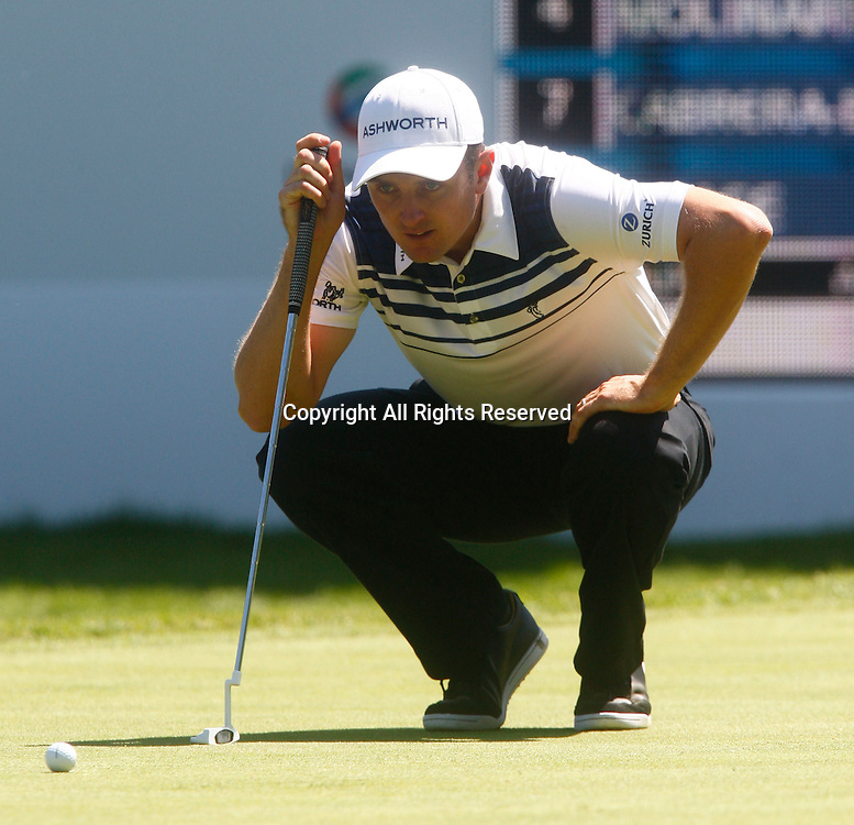 25.05.12 Virginia Water, ENGLAND: <br /> Justin Rose of England on the 18th green lines up his putt<br /> during the second round of the BMW PGA Championship  on the West Course at Wentworth Club <br /> on May 25, 2012 in Virginia Water , England.