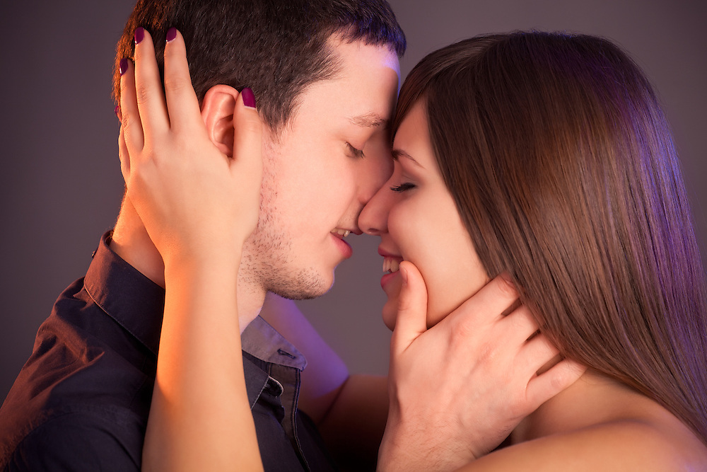 Young couple in love that is about to kiss.