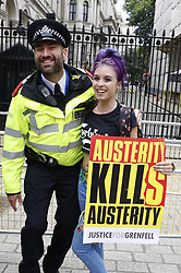 © Licensed to London News Pictures. 01/07/2017. London, UK. The People's Assembly anti-austerity demonstration passes Downing St as it heads towards Parliament. Speakers include Labour Party Leader Jeremy Corbyn. Photo credit: Peter Macdiarmid/LNP