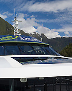 View of Real Journey's cruise ship, Patea Explorer, in the Hall Arm of Doubtful Sound, Fiordland National Park, New Zealand