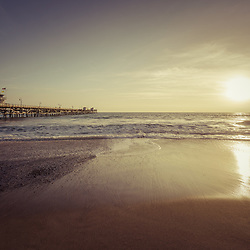 San Clemente pier at sunset retro photo. San Clemente is a popular beach city in Orange County Southern California in the States of America. Copyright ⓒ 2017 Paul Velgos with all rights reserved.