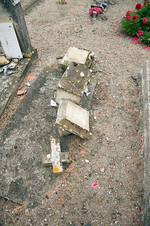 a headstone which has fallen over
