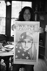 Marlene holds a We The People Poster by Shepard Fairey. We The People Poster by Shepard Fairey were published in the Washington Post as full page ads so anyone could carry a poster at Women's March on Washington, D.C.