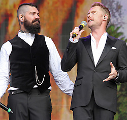 © Licensed to London News Pictures. 13/07/2014, UK. Shane Lynch & Ronan Keating. Boyzone, play British Summer Time at Hyde Park, London UK, 13 July 2014. Photo credit : Brett D. Cove/Piqtured/LNP