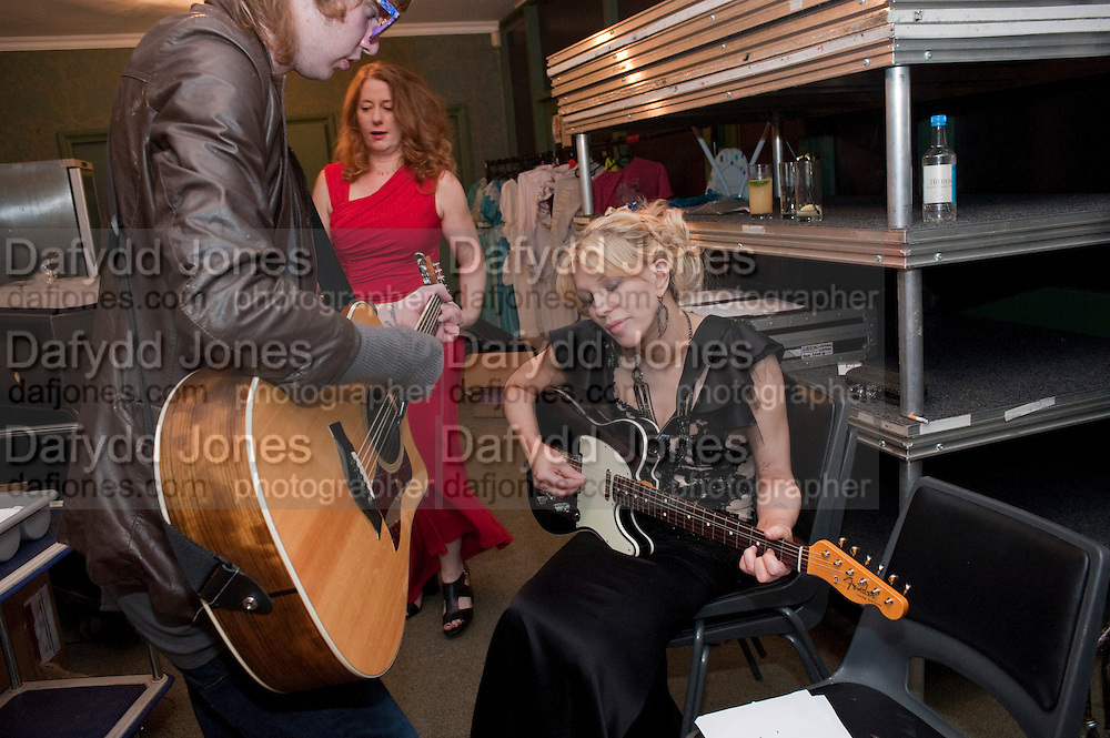 MICKEY; COURTNEY LOVE PRACTICING BEFORE PLAYING, The Goodwood Ball. In aid of Gt. Ormond St. hospital. Goodwood House. 27 July 2011. <br /> <br />  , -DO NOT ARCHIVE-© Copyright Photograph by Dafydd Jones. 248 Clapham Rd. London SW9 0PZ. Tel 0207 820 0771. www.dafjones.com.
