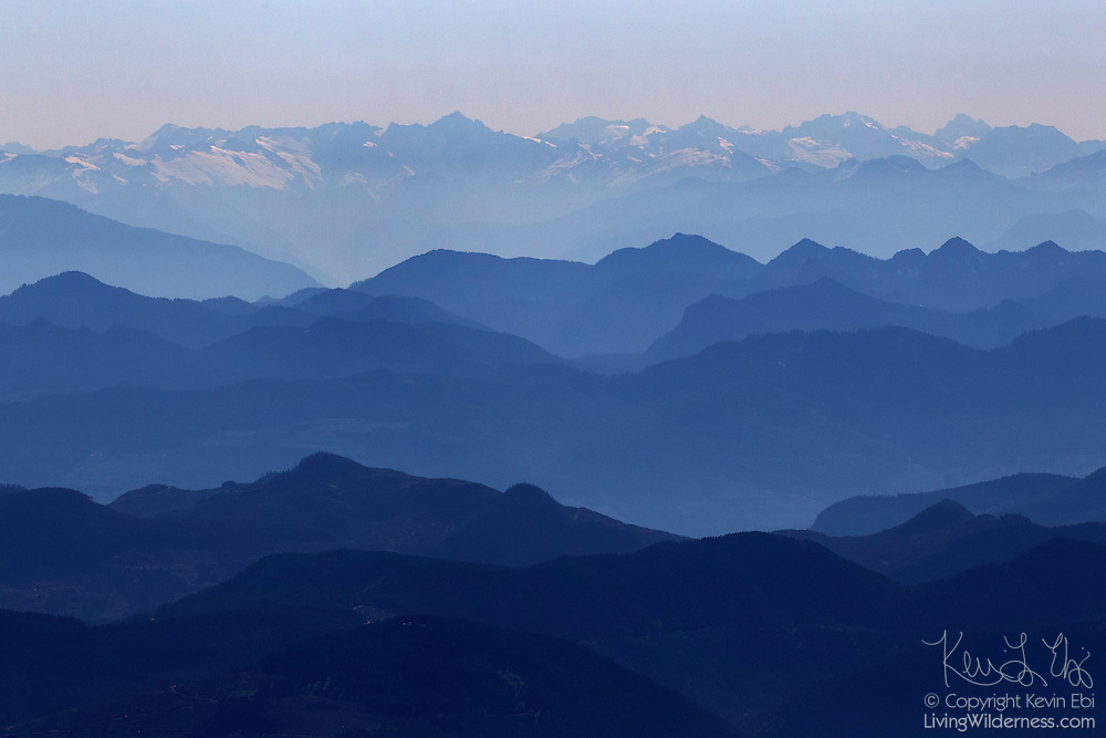 Several rows of mountains in the North Cascades are visible in this aerial view from Skagit County, Washington.