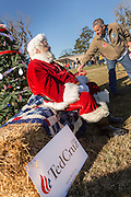 Santa Claus shows his support for Senator and GOP presidential candidate Ted Cruz during a campaign event at Ottawa Farms December 19, 2015 in Bloomingdale, Georgia.