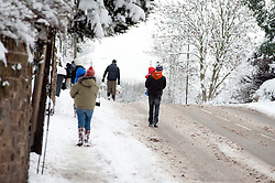 The A629 Cowley Lane Chapeltown Sheffield, people choose to walk rather than take their cars in the most widespread Snows to hit Britain for 20 years.1st December 2010.Images © Paul David Drabble