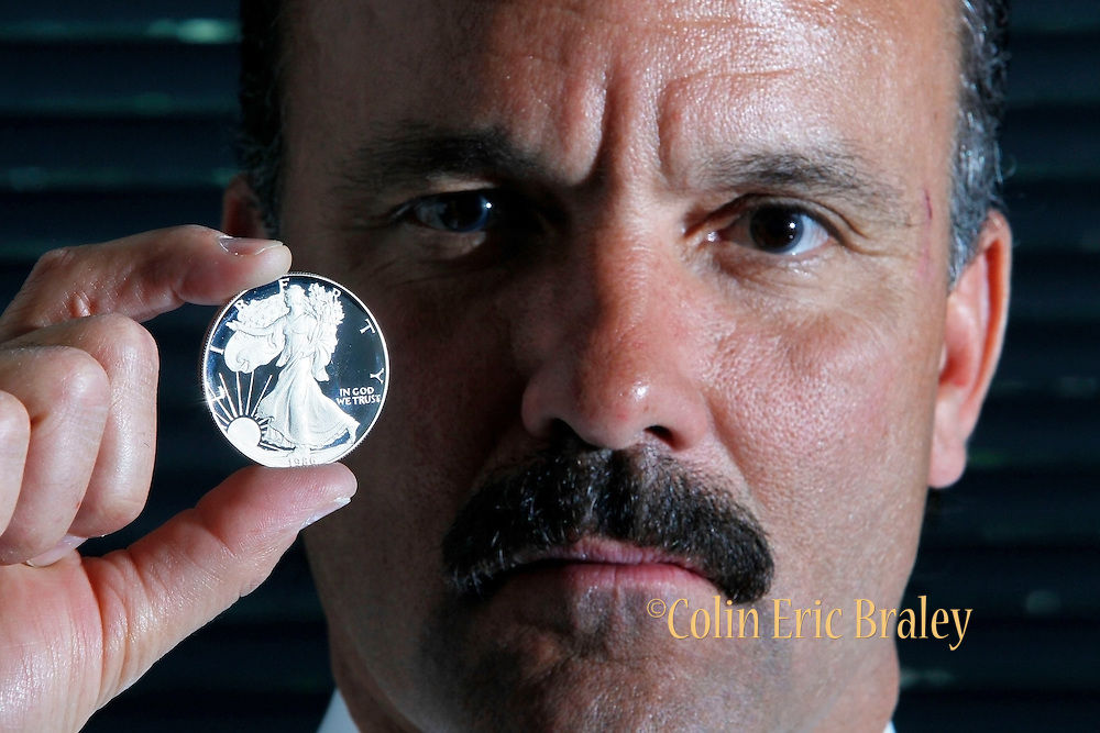 Craig Franco, founder of the Utah Gold and Silver Depository, holds a Liberty Silver Dollar at his office in Salt Lake City, Friday, May 6, 2011. Utah is the first state in the country to legalize gold and silver coins as currency, allowing the state's consumers to use the precious medals to open checking accounts instead of Federal Reserve notes.<br /> <br /> (AP Photo/Colin E Braley)