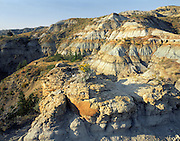 AA02179-03....NORTH DAKOTA - Banded clay hills along Buckhorn Trail in Theodore Roosevelt National Park.