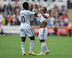 Swansea City's Wayne Routledge celebrates with Swansea City's Wilfried Bony - Photo mandatory by-line: Alex James/JMP - Mobile: 07966 386802 30/08/2014 - SPORT - FOOTBALL - Swansea - Liberty Stadium - Swansea City v West Brom - Barclays Premier League