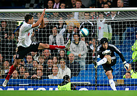 Chelsea v Fulham. Barclays Premier League. 29/09/2007. Petr Cech of Chelsea kicks ball away  while Clint Dempsey of Fulham tries to stop him