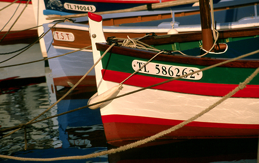 Colourful fishing boats line St Tropez harbour, France
