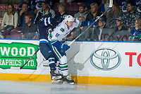 PENTICTON, CANADA - SEPTEMBER 8: Leo Gawanke #70 of Winnipeg Jets is checked into the boards by Cole Candella #68 of Vancouver Canucks on September 8, 2017 at the South Okanagan Event Centre in Penticton, British Columbia, Canada.  (Photo by Marissa Baecker/Shoot the Breeze)  *** Local Caption ***