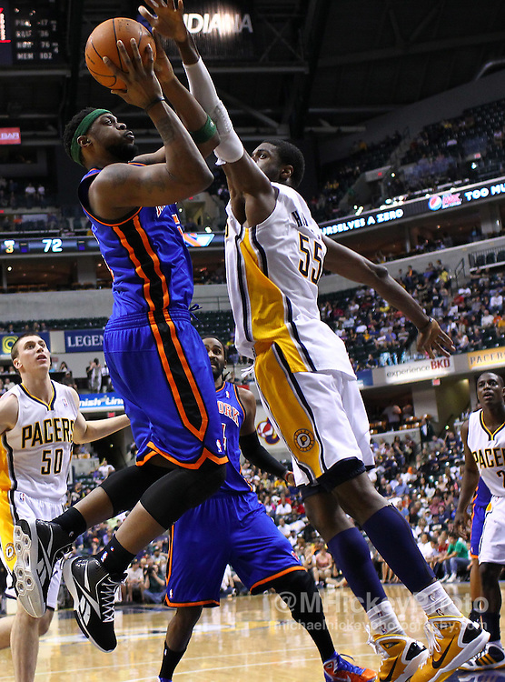 April 10, 2011; Indianapolis, IN, USA; New York Knicks shooting guard Bill Walker (5) goes up for a jump shot against Indiana Pacers center Roy Hibbert (55) at Conseco Fieldhouse. Mandatory credit: Michael Hickey-US PRESSWIRE