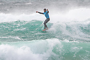 Ben Skinner (UK) 'hanging five' during the Boardmasters Longboard Pro at Fistral Beach, Newquay, Cornwall, United Kingdom on 10 August 2019.