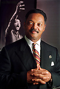 Rev. Jesse Jackson stands in front of a photo of a more youthful Jackson that hangs outside his office at Rainbow/PUSH headquarters in Chicago July 20, 1999.  (Photo by John Zich)